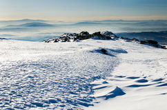 Winter landscape. With several rocks and mountain layers in background Royalty Free Stock Photos