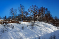 Winter landscape with sheds and wooden fences Stock Images