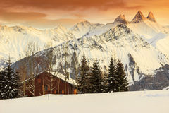Winter landscape and shelter in french Alps,Les Sybelles,France. Shelter and wonderful peaks in background,Aiguilles D'arves,France Stock Image