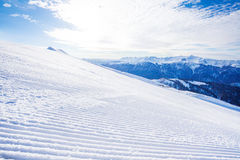 Winter landscape of ski-track and Caucasus hills. Winter landscape of snow ski-track and Caucasus mountains during sunny day in Sochi ski resort Krasnaya polyana Stock Images