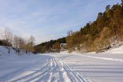 Winter landscape. Ski track in the snow. Frozen river royalty free stock photo