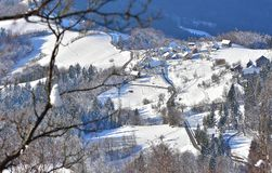 Winter landscape in Slovenia. View from Tolsti vrh. On the photo is winter landscape from Slovenia. With tipicaly village on the hill Royalty Free Stock Photos