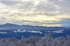 Winter landscape in Slovenia, Zasavje. On the photo is winter landscape from Slovenia. On the left side of photo you can see mountain Kum Stock Image