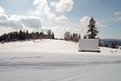 Winter landscape with a small cottage Royalty Free Stock Photography