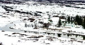 Winter landscape of small wooden church and houses at Thingvelli Royalty Free Stock Photography