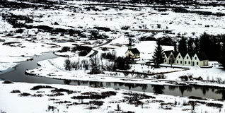 Winter landscape of small wooden churchand houses at Thingvellir Royalty Free Stock Photos