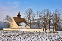 Winter landscape with snow. Beautiful chapel near castle Veveri. Czech Republic city of Brno. The Chapel of the Mother of God. Royalty Free Stock Image