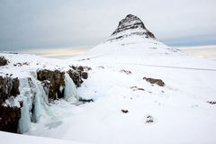 Winter landscape with snow-capped Kirkjufell mountain, Snaefellsnes peninsula, Iceland Stock Images
