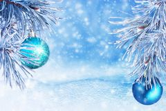 Winter landscape with snow. Christmas background with fir branch and Christmas ball.Merry Christmas and happy New Year greeting ca. Rd with copy-space stock photography