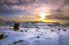 Winter landscape with snow, clouds and sunset. Winter landscape with snow, clouds and sunset, Neapoli, Crete royalty free stock photos