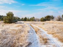 Winter Landscape Of Snow-Covered Dirt Road On A Sunny Day Royalty Free Stock Images