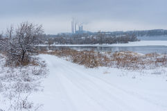 Winter landscape with snow covered earth road Royalty Free Stock Photo