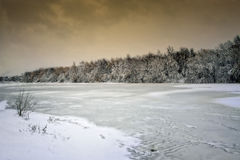 Winter landscape of snow-covered fields, trees and river in the Stock Images
