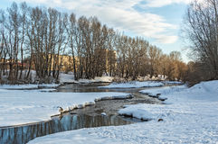 Winter landscape of snow-covered fields, trees and river in the early misty morning Royalty Free Stock Photo