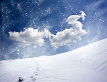 Winter landscape with snow covered hill and blue sky Royalty Free Stock Photos