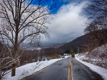 Winter landscape and snow covered roads in the mountains Stock Images