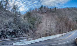 Winter landscape and snow covered roads in the mountains Stock Photos