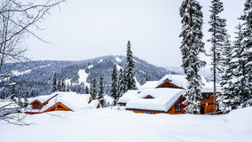 Winter Landscape with Snow Covered Roofs in the Alpine Village of Sun Peaks Royalty Free Stock Photos