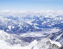 Winter landscape with snow covered slopes and blue sky, with Aerial view of Zell am See lake from the top of. Kitzsteinhorn mountain on . Kaprun ski resort stock photo