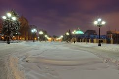 Winter landscape of snow-covered square with two rows of lanterns in front of the Verkhovna Rada of Ukraine stock image