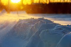 Winter landscape with snow-covered at sunset in snowstorm, sunset snow blizzard. Winter landscape with snow-covered at sunset snowstorm, sunset snow blizzard Stock Image