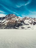 Winter landscape of snow mountain background. Winter landscape of snow mountain against blue sky. Beautiful nature scenery background Royalty Free Stock Images