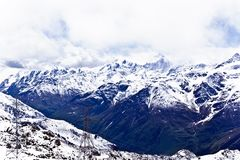 Caucasus mountains under fluffy snow stock image