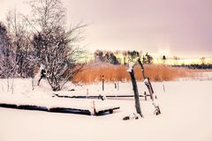 The winter landscape, snow, pier on the lake Stock Photography