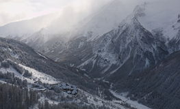Winter landscape with snow and village. Winter view Alps with fresh snow and a village Stock Photography