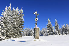 Winter landscape and snow wrapped trees, stone cross Royalty Free Stock Images