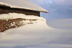 Winter landscape with snowcapped wooden hut stock photo