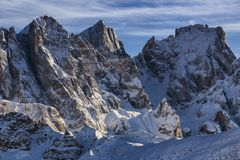 Dolomites mountains, view from passo san pellegrino. Winter landscape with snowcovered mountains, dolomites, italy, passo san pellegrino towards falcade Stock Photos