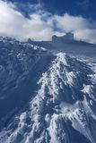 Winter landscape with an observatory atop a mountain Royalty Free Stock Photos