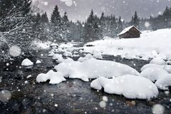 Winter landscape with snowing, fresh snow. In the mountains. Christmas greetings Stock Images