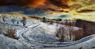 Countryside road at sunset, winter Stock Images