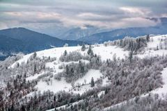 Winter landscape, snowy mountains covered with forest stock images