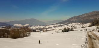Winter landscape in snowy mountains stock photos