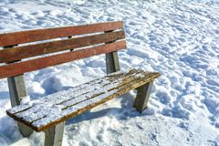 Winter landscape with snowy wooden bench. Winter sanny day Stock Photo