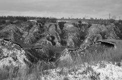 Winter landscape with soil erosion in black and white version. Stock Image