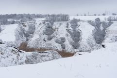 Winter landscape with soil erosion in suburb of Dnipro city, Ukraine Royalty Free Stock Photography