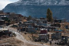 Winter landscape South Africa with snow. Capped mountains and informal settlement in foreground Eastern Freestate South Africaow Stock Images
