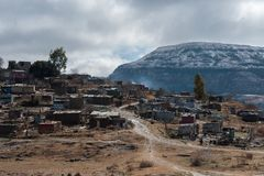 Winter landscape South Africa with snowcapped mountains and informal settlement in foreground. Eastern Freestate South Africa Stock Photos