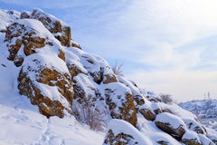 Winter landscape with spotted rocks Stock Photos