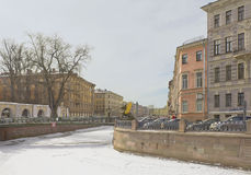 Winter landscape in St. Petersburg, Russia. Winter landscape with frozen canal in St. Petersburg Stock Photo