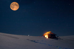 Winter landscape with a starry sky and the full moon. Royalty Free Stock Image