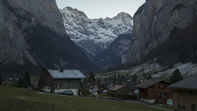 Winter landscape stunning touristic town with high cliffs in background,Lauterbrunnen. Winter landscape stunning touristic town with high cliffs in background stock images