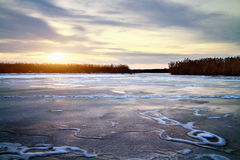 Winter landscape with sun and frozen river. Stock Photography