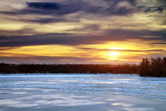 Winter landscape with sun and frozen river. Royalty Free Stock Photos
