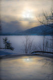 Winter landscape with sun reflection Stock Image