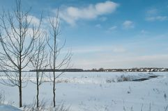 Winter landscape on a Sunny day. Winter in the village Stock Photography
